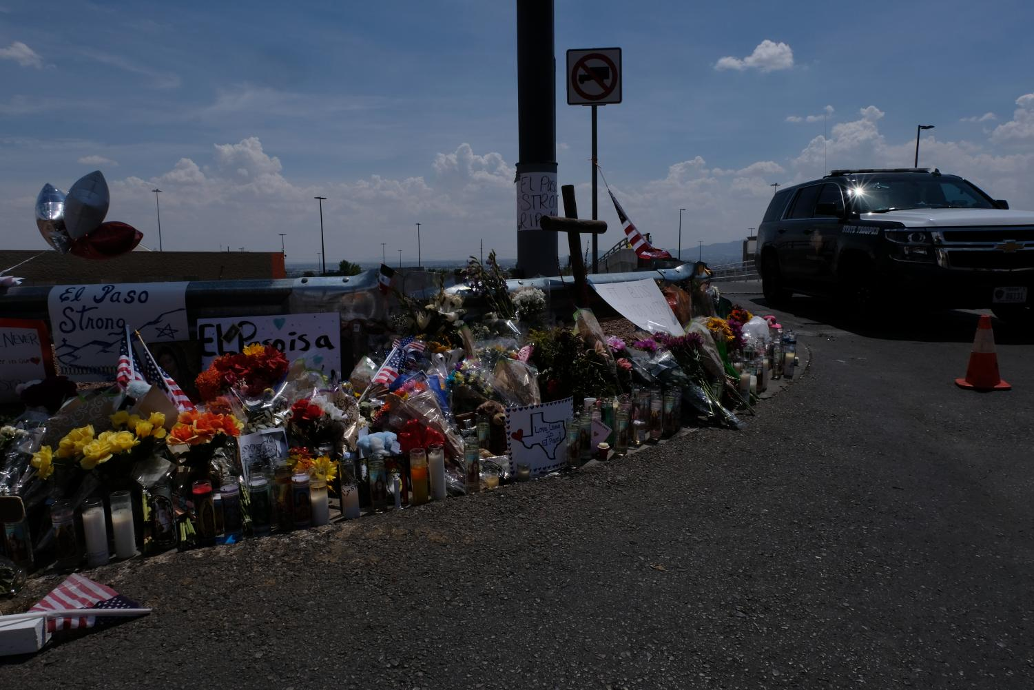 Candles and signs that read El Paso Strong are many items that were included in memorials for the victims of Saturday's mass shooting.