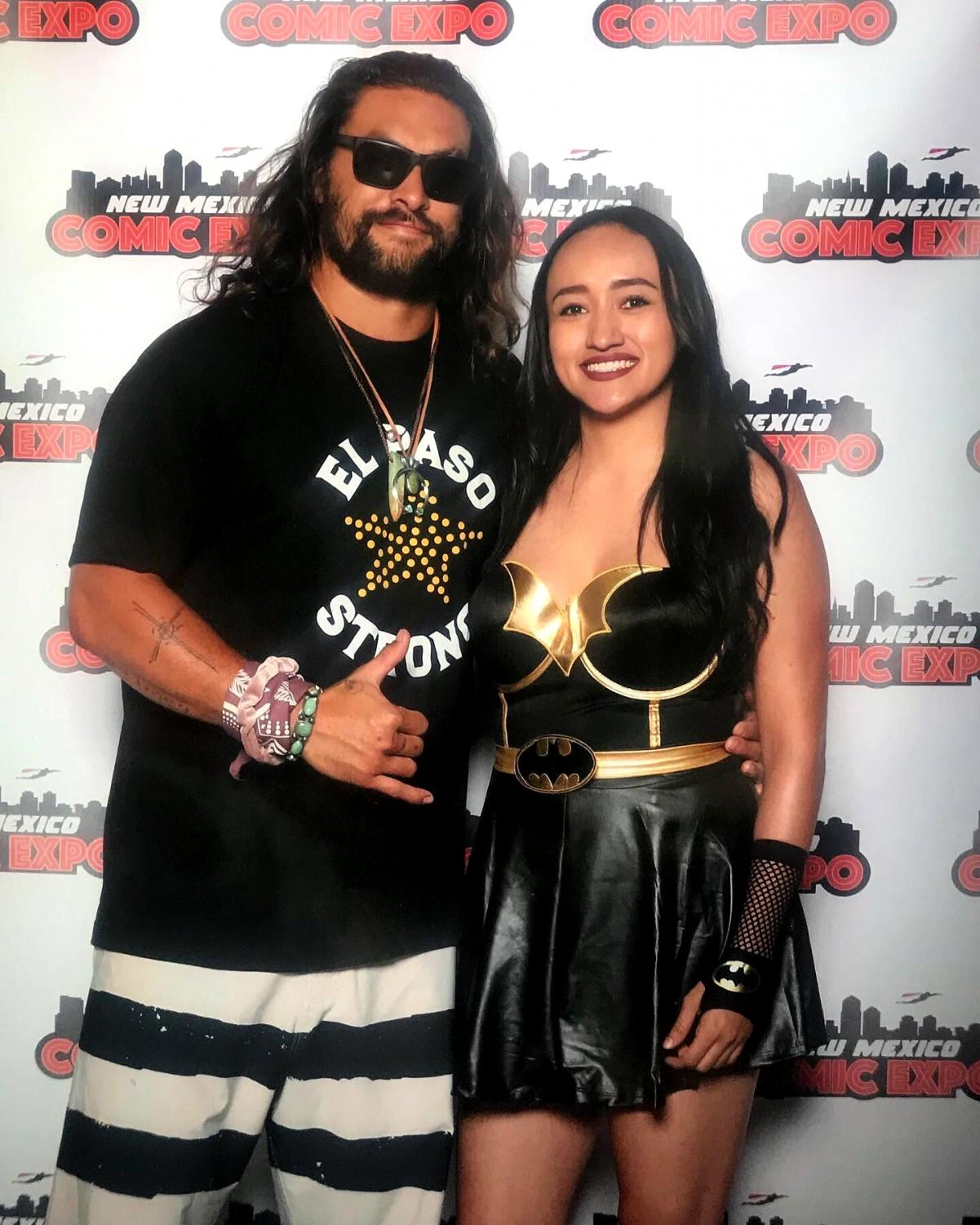 Jason Momoa takes a photo with fan while wearing an El Paso Strong shirt.