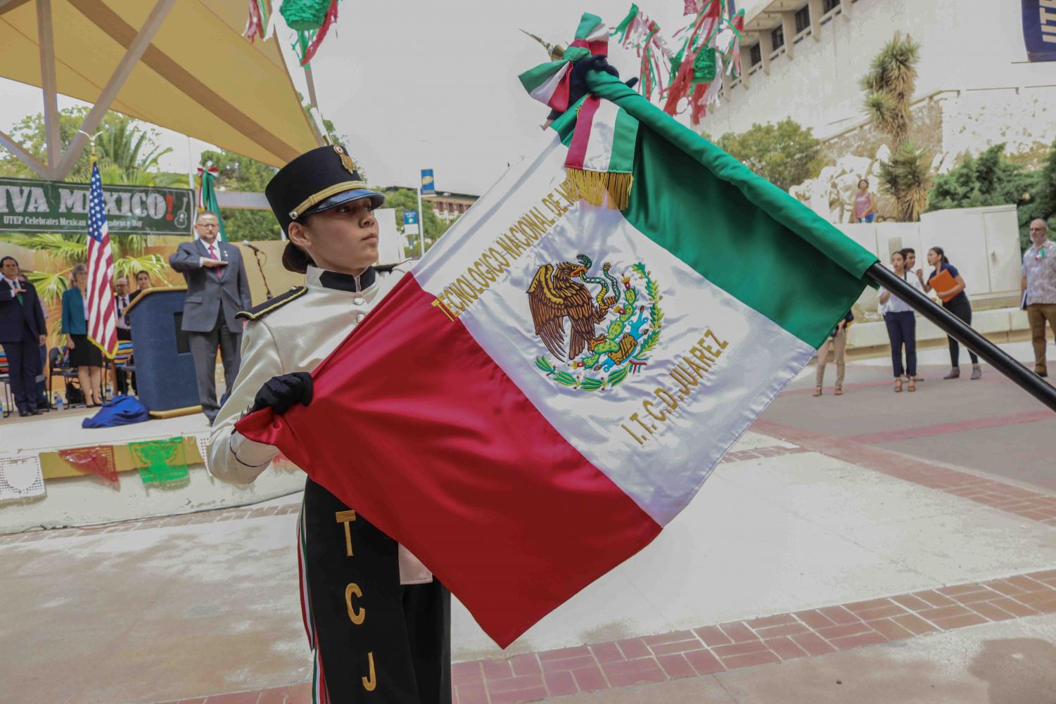 """Escolta leader folds Mexican flag at """"El Grito"""" at the Union Plaza on Sept 13, 2019."""