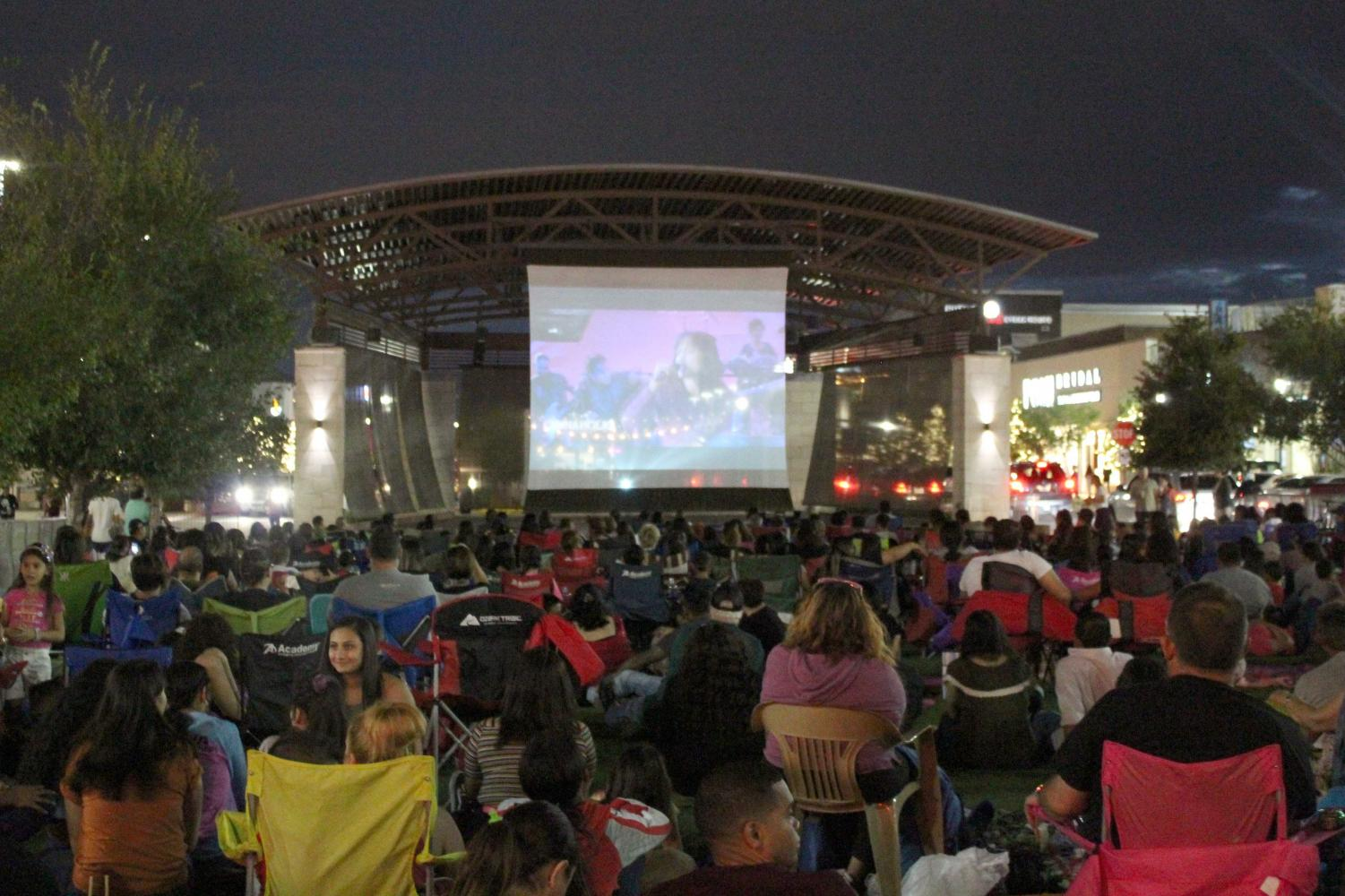 """People gather to watch the film """"Selena"""" at the Fountains at Farah Saturday Sept. 14., 2019."""