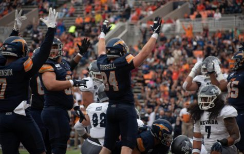 UTEP players celebrate thier first touchdown of the game against the University of Nevada.