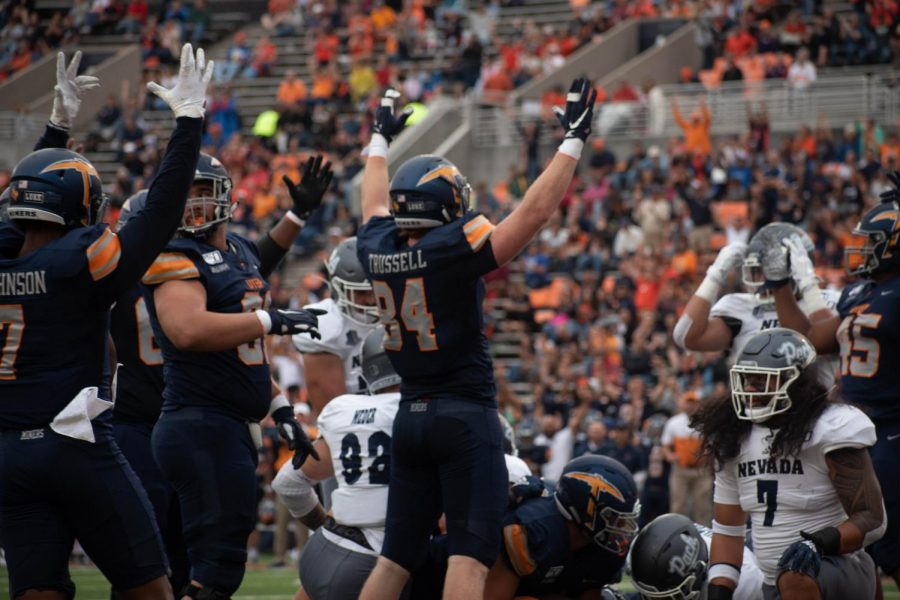UTEP+players+celebrate+thier+first+touchdown+of+the+game+against+the+University+of+Nevada.