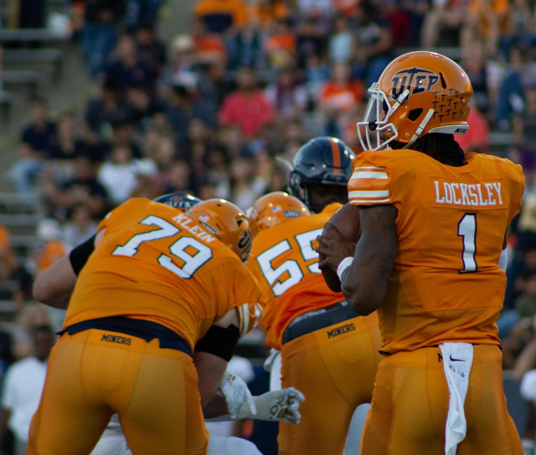 Senior quarterback Kai Locksley looks for a receiver down field against UTSA at the Sun Bowl.