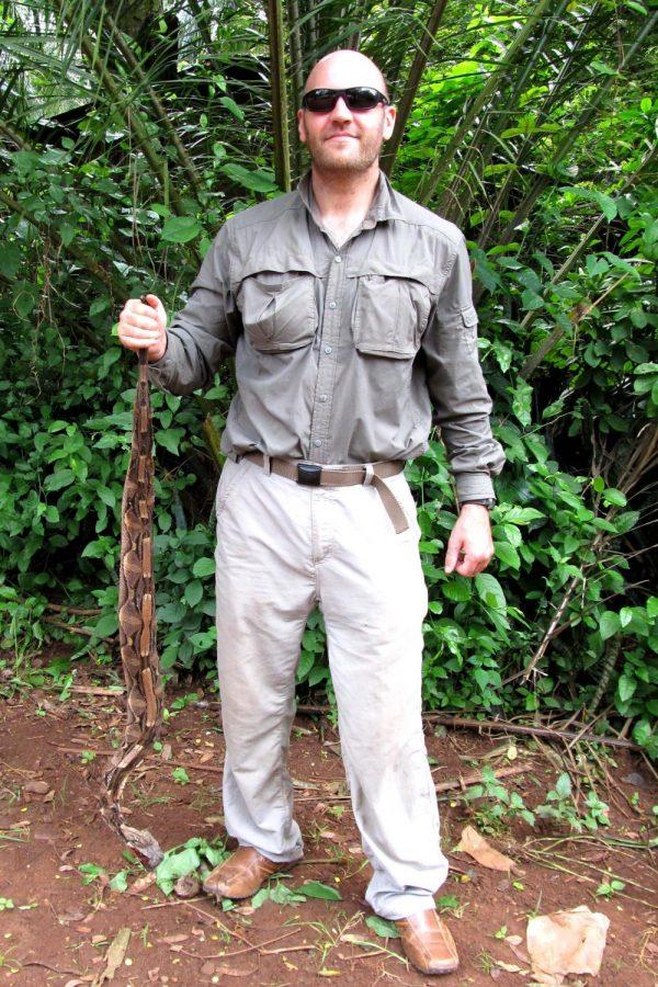 Eli+Greenbaum%2C+Ph.D.%2C+an+associate+professor+of+biological+science+at+UTEP%2C+holds+a+Gaboon+viper+in+Congo%2C+Africa.