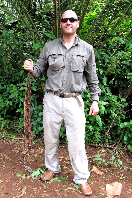 Eli Greenbaum, Ph.D., an associate professor of biological science at UTEP, holds a Gaboon viper in Congo, Africa.