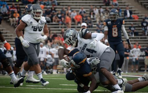 UTEP player Joshua Fields is finally brought down by two defenders against the University of Nevada.