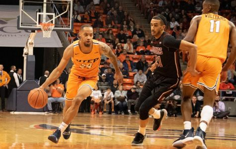 Graduate student and UTEP guard Daryl Edwards drives the ball to the net against NMSU at the Don Haskins Center.