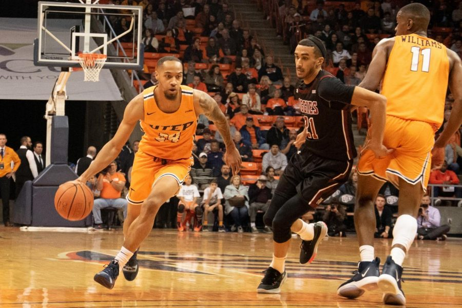 Graduate+student+and+UTEP+guard+Daryl+Edwards+drives+the+ball+to+the+net+against+NMSU+at+the+Don+Haskins+Center.