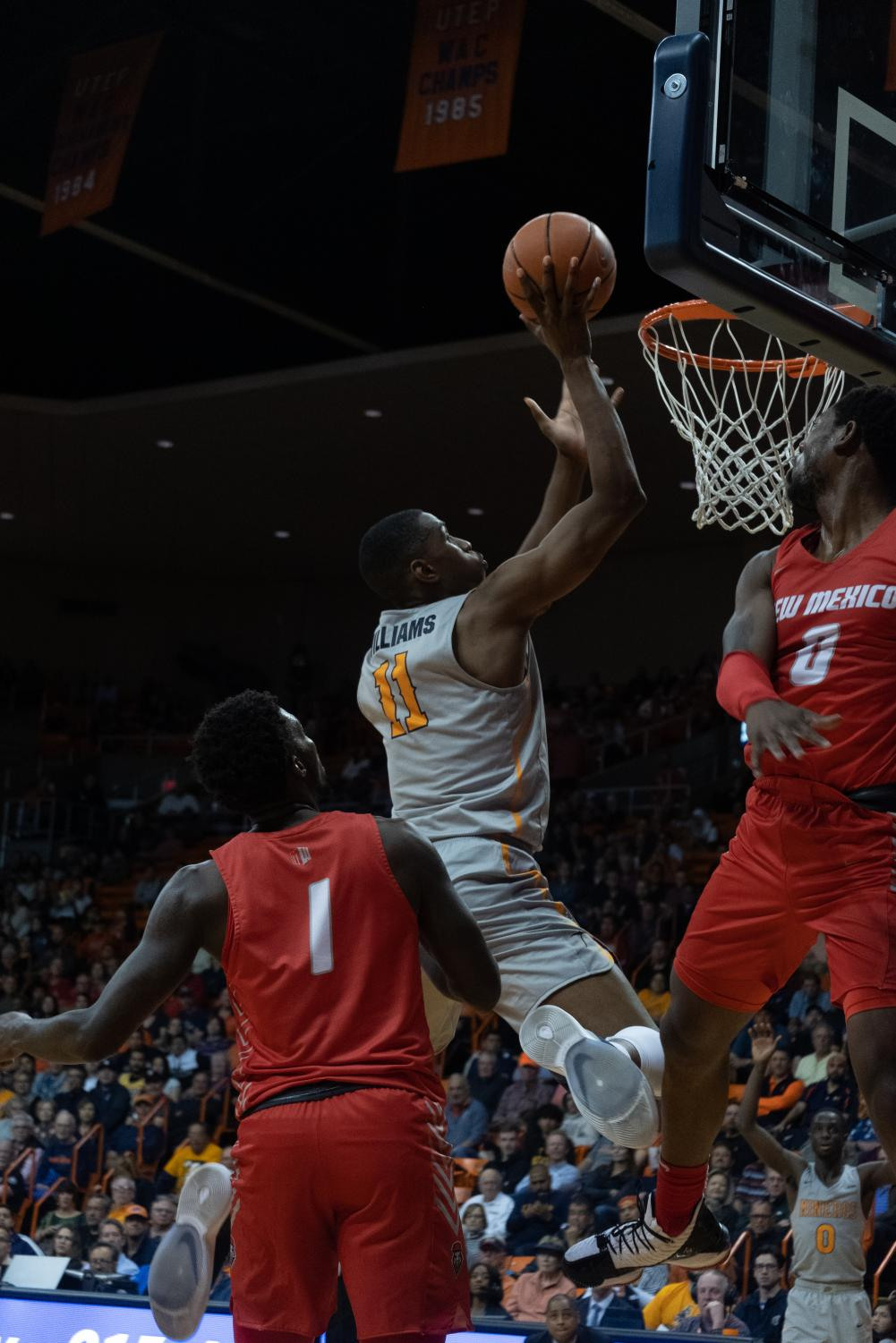 UTEP junior forward Bryson Williams drives to the basketball against UNM at the Don Haskins Center.