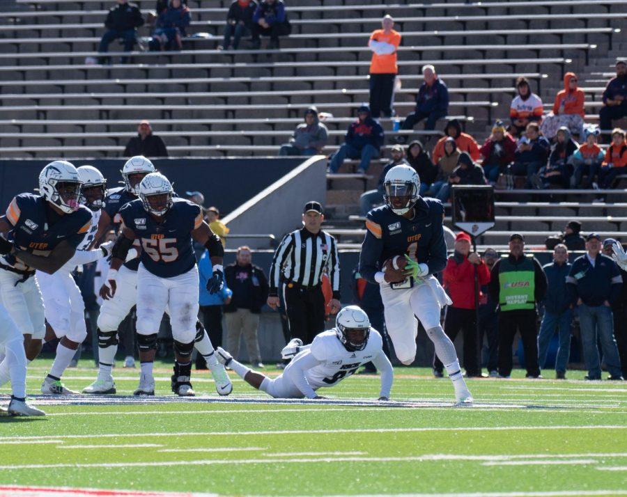 UTEP+senior+quarterback+Kai+Locksley+rushes+against+the+Rice+defense+Nov.+30+at+the+Sun+Bowl.