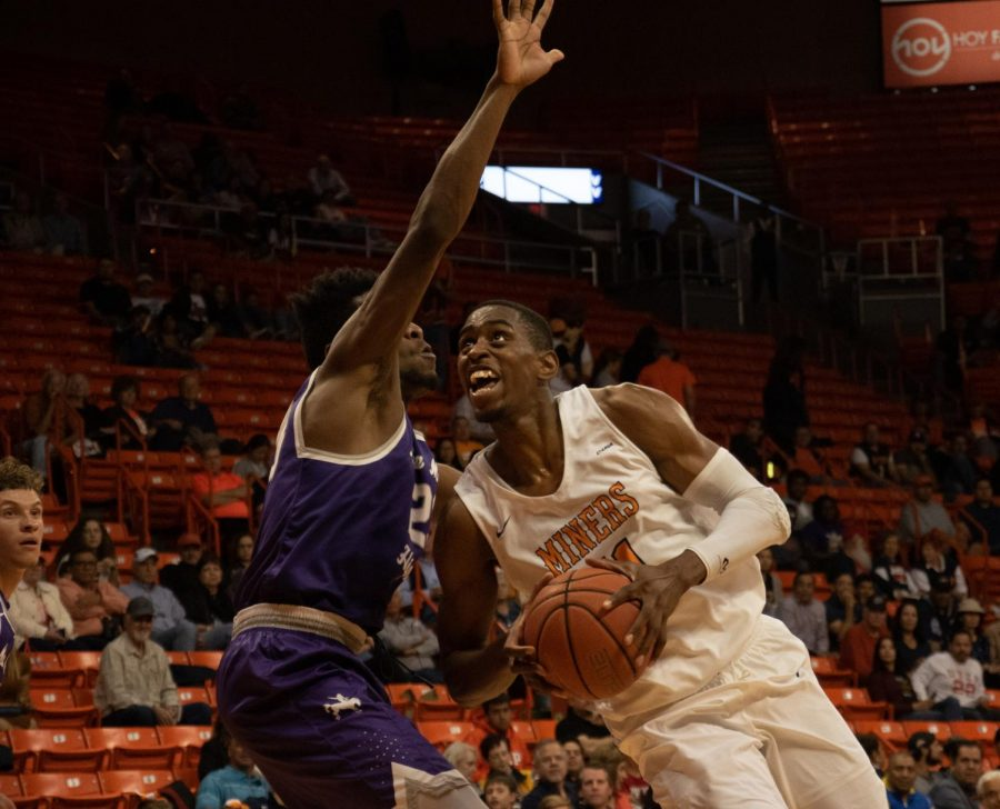 Junior forward Bryson Williams powers through a defender late in the second half to score another two points against New Mexico Highlands University at the Don Haskins Center.