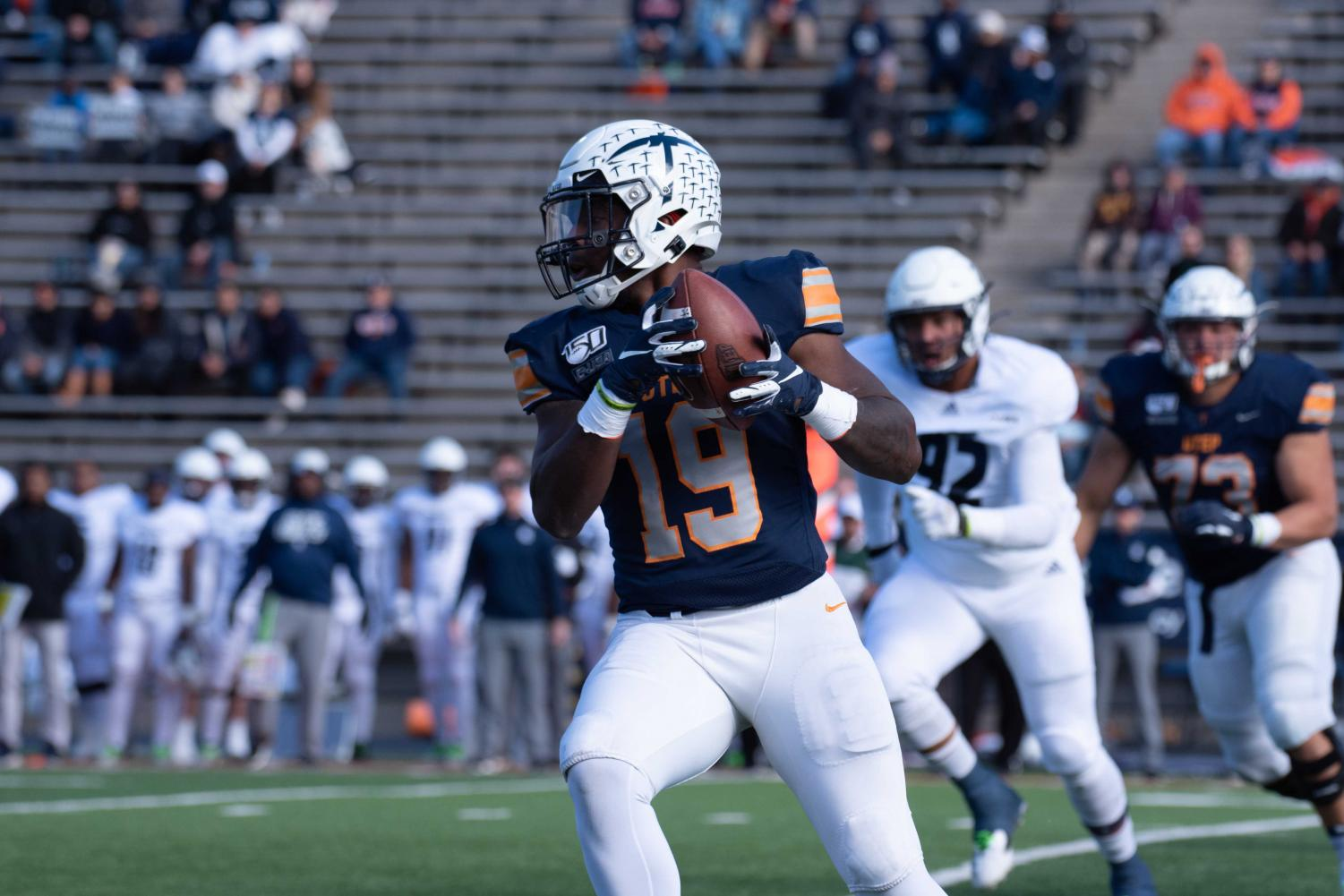Senior Runningback Treyvon Hughes catches a screen pass and turns up field against the Rice Owls at the Sunbowl stadium.