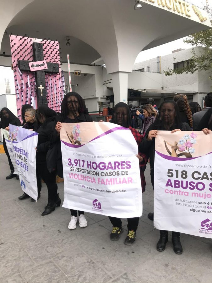 Anti-femicide advocates standing in solidarity to protests the disappearances and deaths of women throughout the country late November in front the Paso del Norte international port of entry.