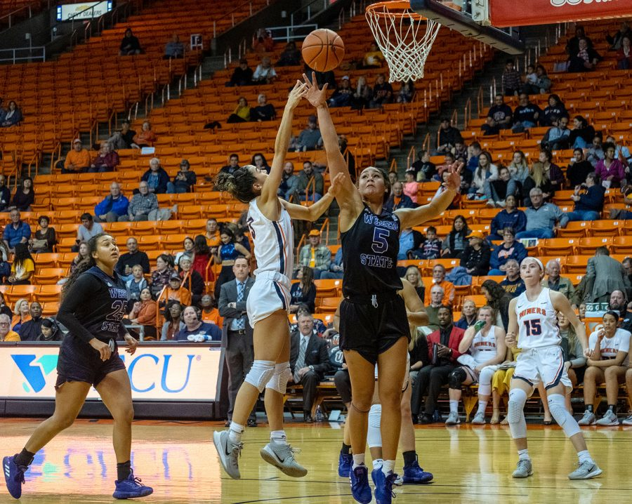 UTEP  all confernce guard Katia Gallegos shoots over Weber State defender Dec. 5 2019.