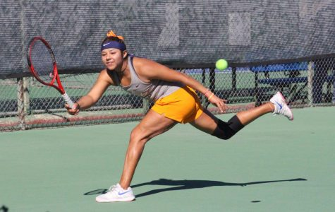 Junior Erandi Martinez dashes to return serve in win versus Eastern New Mexico University Saturday Jan. 25, 2019.