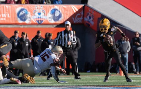 Arizona State freshman quarterback Jayden Daniels runs for positive yards at the 86th annual Tony The Tiger Sun Bowl.