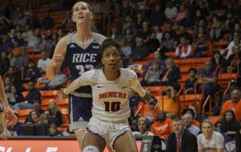 UTEP senior forward Jade Rochelle boxes out Rice junior center Nancy Mulkey Jan. 24 at the Don Haskins Center.