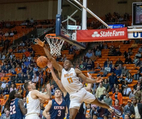 Junior forward Bryson Williams fights for loose ball versus UTSA Jan. 15.
