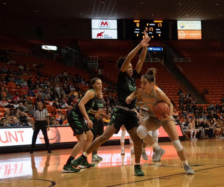 UTEP+freshman+guard+Katia+Gallegos+tries+to+work+around+a+North+Texas+defender+at+the+Don+Haskins+Center.+
