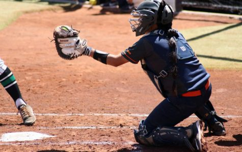 Catcher Linda Garcia ready for the throw of pitcher Kira McKechnie Sunday April 15 at Helen of Troy Softball Complex.