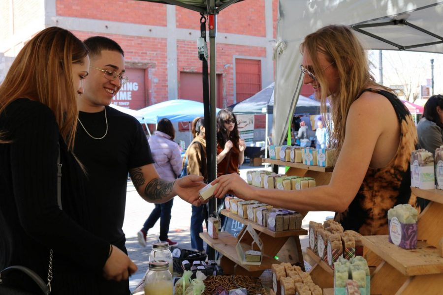 Customers browsing the selection of products offered by Hueco Valley Soaps & Lotions, a business run by Elizabeth Dominguez and her grandson Justice Hill, this past Saturday, Feb. 15 at the El Paso Downtown Artist & Farmers Market.
