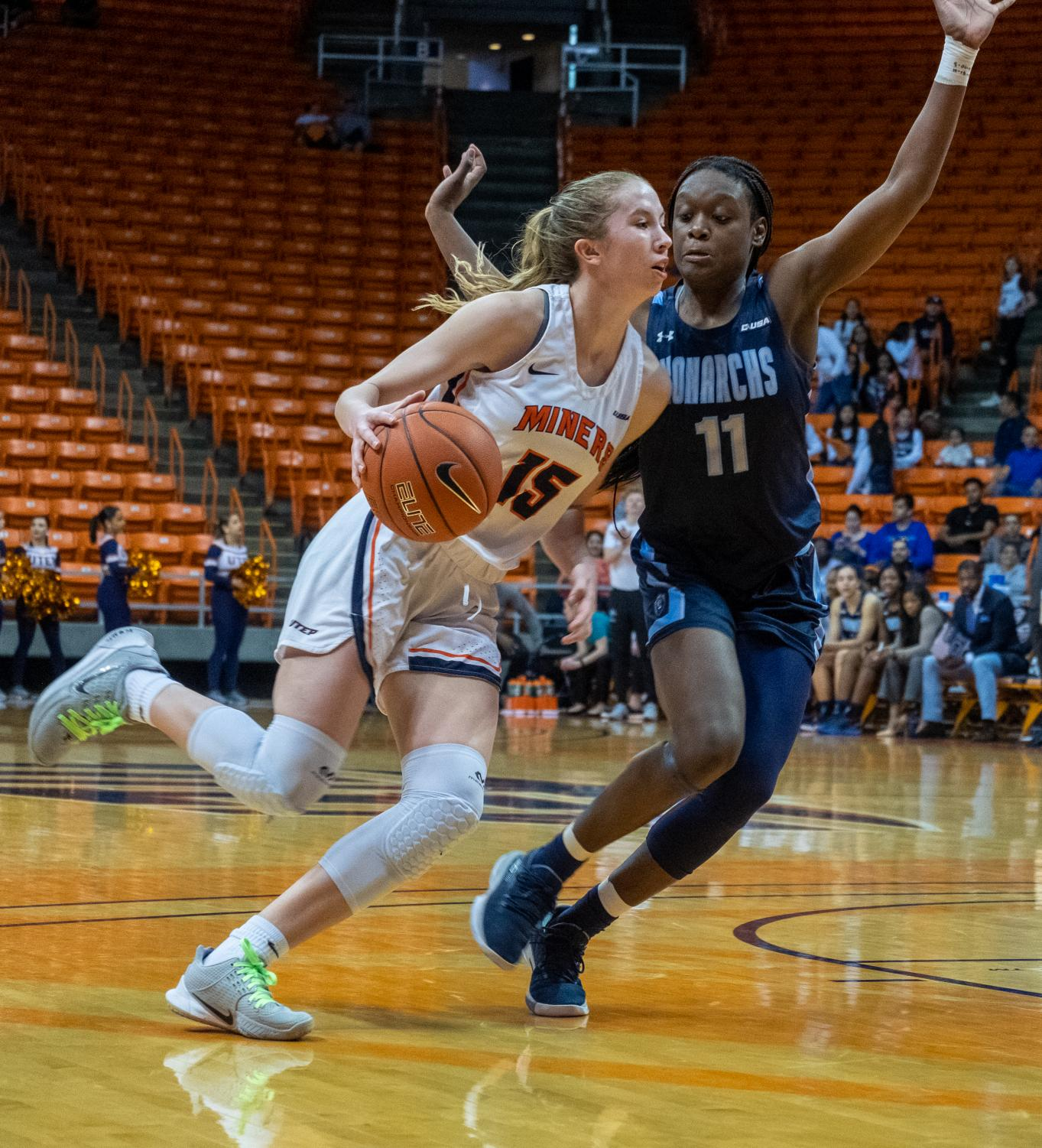 UTEP freshman guard  drives with heavy pressure from Old Dominion guard Taylor Edwards Saturday, Feb. 8.