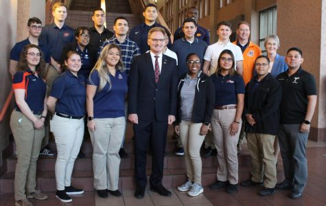 Thomas Modly, Acting Secretary of the Navy, possess with UTEP students Tuesday, Jan. 28, 2020, following his Centennial Lecture on the importance of critical thinking in order to combat global challenges.
