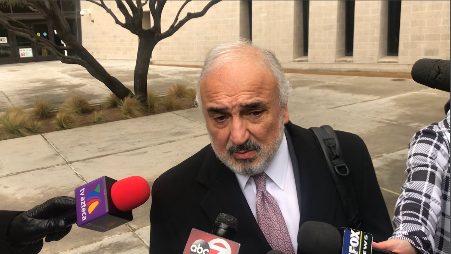 El Paso-based defense attorney Joe Spencer speaks with reporters outside U.S. District Court following a hearing for Patrick Wood Crusius, who is accused of killing 22 people and injuring 23 more in a mass shooting at an El Paso Walmart on Aug. 3, 2019. The 90-count indictment charges Crusius with hate crimes.