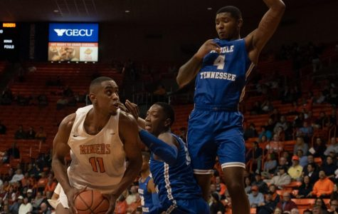 Junior forward Bryson Williams drives to basket against two Middle Tennessee State defenders Jan. 30.