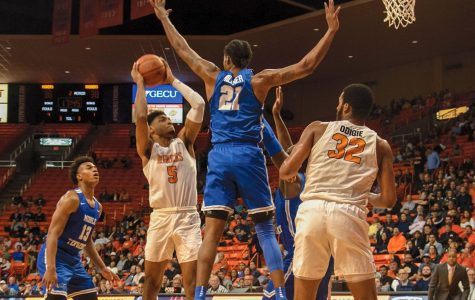 Freshman guard Deon Stroud pulls up for a jumper over Blue Raider defender versus Middle Tennessee State Jan. 30.