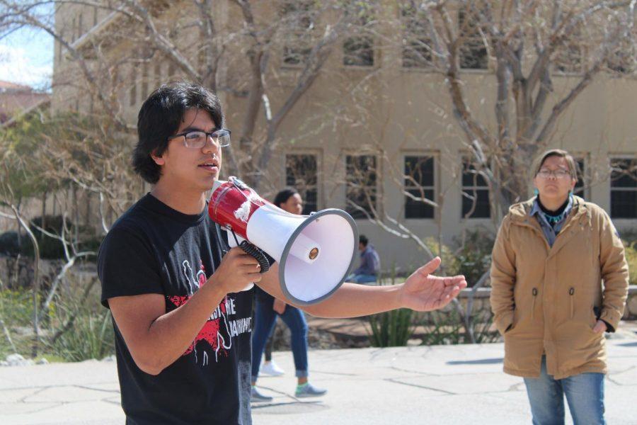 UTEP student holds megaphone as he speaks against Coastal GasLink's multi-billion-dollar pipeline project on Wednesday Mar. 5 at Centennial Plaza.