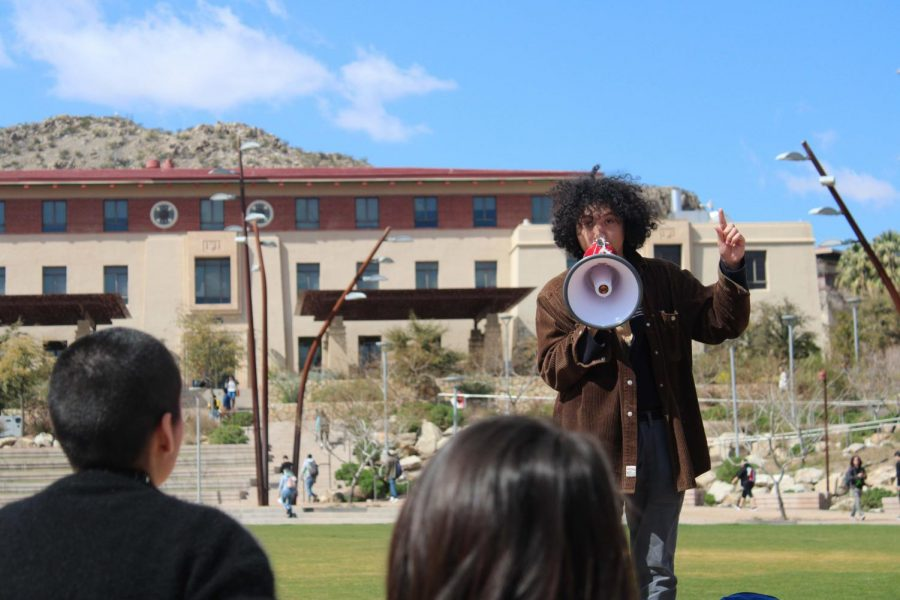 UTEP student speaks at Centennial Plaza on March 5 in front of audience members opposing a gas pipeline planned on being constructed on indigenous land.