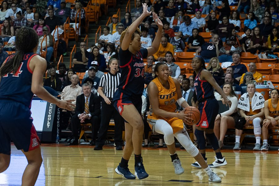 UTEP senior forward Ariona Gill drives the basket versus Arizona Dec. 7 2019.