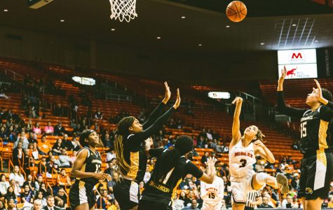 Freshman point guard Katia Gallegos shoots the ball through three Southern Miss defenders Saturday Feb. 29.