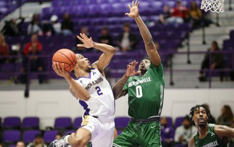 North Alabama sophomore guard Christian Agnew looks to shoot over Jacksonville defender in win Jan. 2.