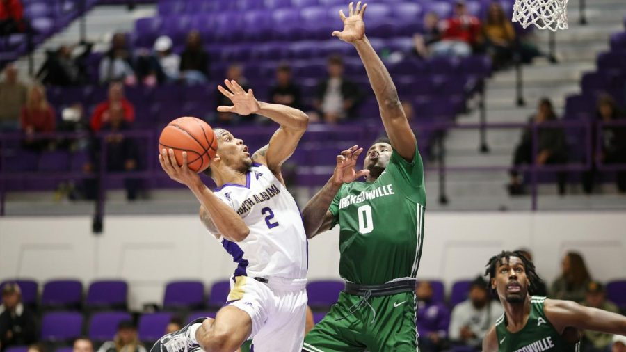 North+Alabama+sophomore+guard+Christian+Agnew+looks+to+shoot+over+Jacksonville+defender+in+win+Jan.+2.+
