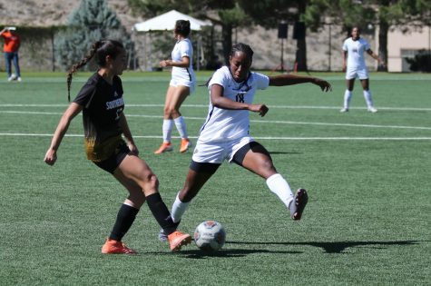 UTEP senior defender Lauren Crenshaw fights for ball with Southern Miss player Feb 10.