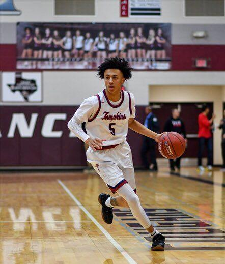 Incoming junior guard Emmanuel White bringing ball down court for Obra Tompkins High School.