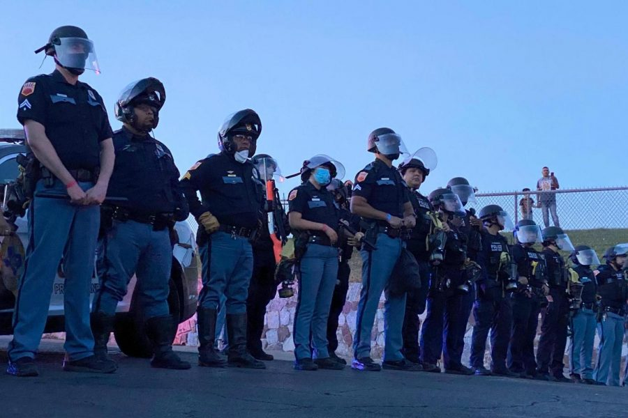 El Paso Police Department line up outside Memorial Park at the protest for George Floyd Sunday, May 31.