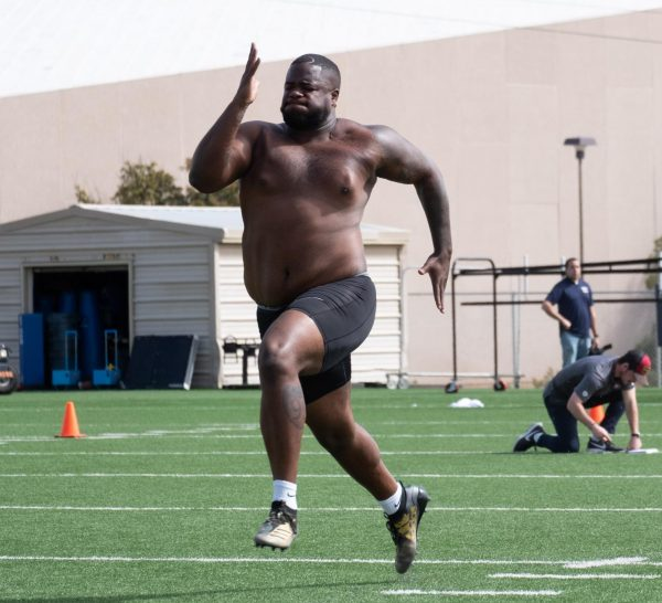 UTEP senior defensive tackle Dedrick Simpson runs 40-yard dash at pro day  March 11.