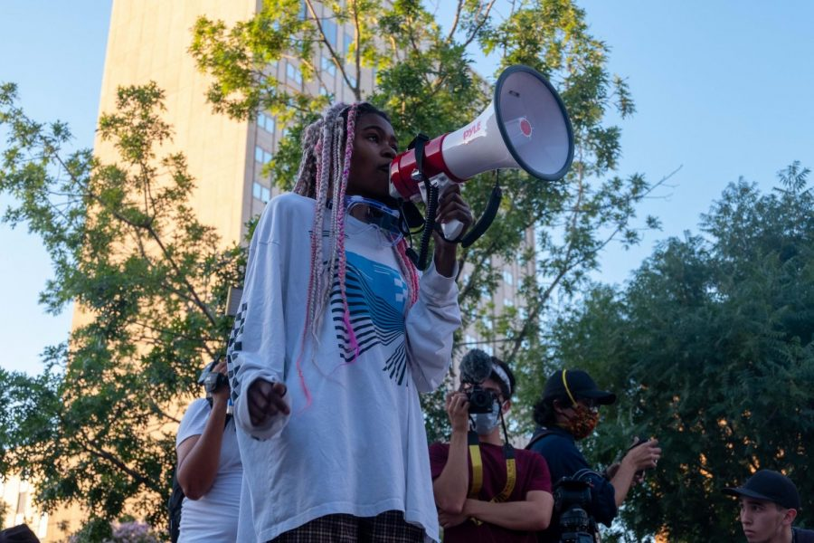 Katie Titan address protest crowd in San Jacinto Plaza during Defund the Police rally in downtown El Paso June 2010.
