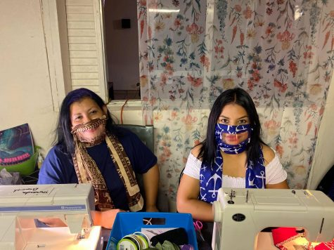 Las Cruces, New Mexico residents Karla Martinez and daughter  Lesley Campa  sit behind their home work area to produce masks for the hearing impaired June 3.