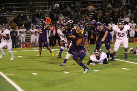 Burges High School running back Tavorus Jones bursts through the line of scrimmage in playoff game versus Yselta High School Nov. 15, 2019.