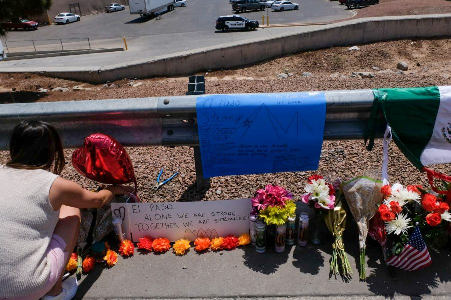 A woman pays her respects to the victims of Aug. 3, 2019 mass shooting at Cielo Vista Walmart.