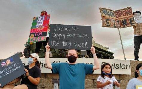 Protesters hold up signs outside of Fort Bliss to demand justice for missing Fort Hood soldier Vanessa Guillen July 4, 2020.