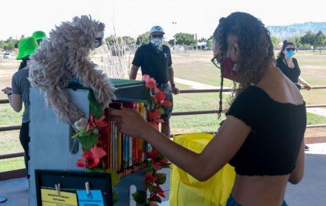 UTEP senior Kierra Lopez-Robinson sets up her mobile library for her program she calls