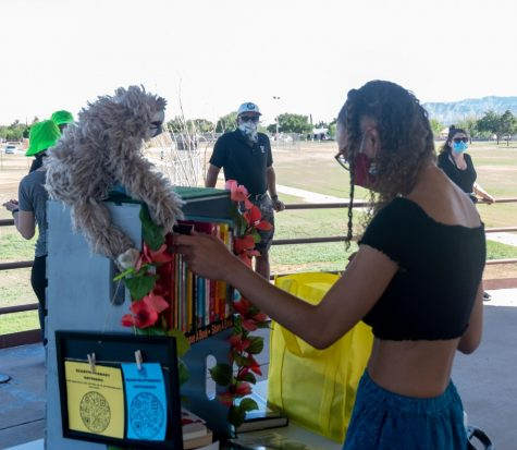 "UTEP senior Kierra Lopez-Robinson sets up her mobile library for her program she calls "" Readvolution"" during a Juneteenth event in Northeast El Paso June 19, 2020"