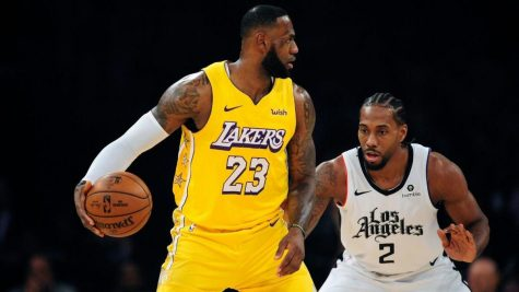The Los Angeles Lakers battle the Los Angeles Clippers in the NBA season restart opener.