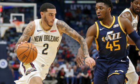 Oct 11, 2019; New Orleans, LA, USA; New Orleans Pelicans guard Lonzo Ball (2) drives against Utah Jazz guard Donovan Mitchell (45) in the first quarter at the Smoothie King Center. Mandatory Credit: Chuck Cook-USA TODAY Sports