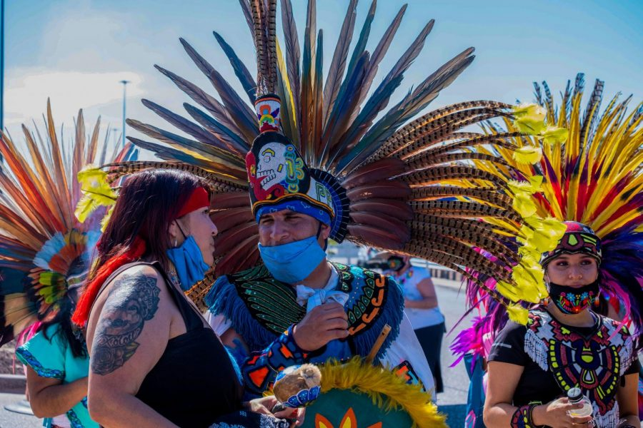 Members  of Danza Azteca Tianeztica gather after performing at Cielo VIsta Walmart memorial honoring the victims of last years mass shooting Aug. 3, 2020.